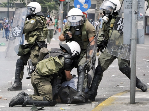 http://roarmag.org/wp-content/uploads/2011/06/J-29-austerity-riots-Greece-crop-07.jpg