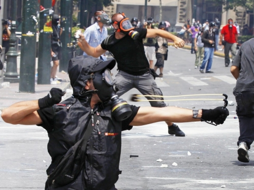 http://roarmag.org/wp-content/uploads/2011/06/J-29-austerity-riots-Greece-crop-08.jpg