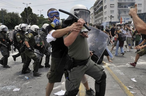 http://roarmag.org/wp-content/uploads/2011/06/J-29-austerity-riots-Greece-crop-10.jpg