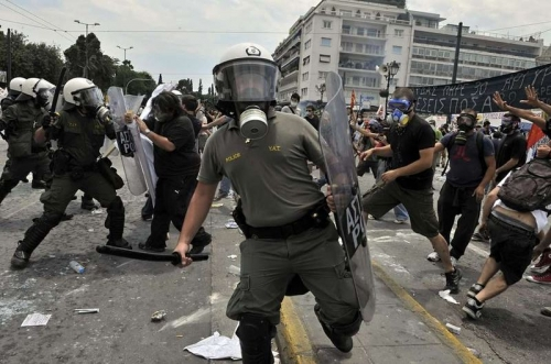 http://roarmag.org/wp-content/uploads/2011/06/J-29-austerity-riots-Greece-crop-16.jpg