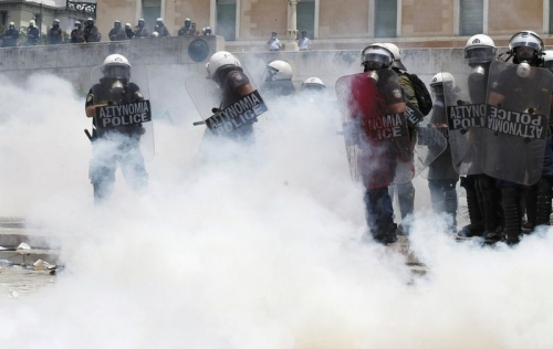 http://roarmag.org/wp-content/uploads/2011/06/J-29-austerity-riots-Greece-crop-18.jpg