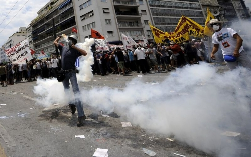 http://roarmag.org/wp-content/uploads/2011/06/J-29-austerity-riots-Greece-crop-19.jpg