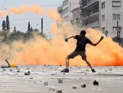 http://roarmag.org/wp-content/uploads/2011/06/J-29-austerity-riots-Greece-crop-30.jpg