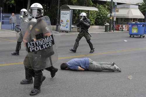 http://roarmag.org/wp-content/uploads/2011/06/J-29-austerity-riots-Greece-crop-31.jpg