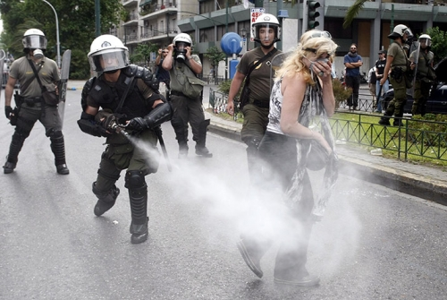 http://roarmag.org/wp-content/uploads/2011/06/J-29-austerity-riots-Greece-crop-32.jpg