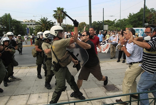 http://roarmag.org/wp-content/uploads/2011/06/J-29-austerity-riots-Greece-crop-33.jpg