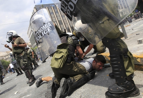 http://roarmag.org/wp-content/uploads/2011/06/J-29-austerity-riots-Greece-crop-36.jpg