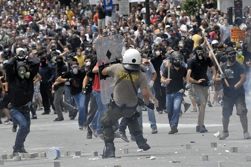 http://roarmag.org/wp-content/uploads/2011/06/J-29-austerity-riots-Greece-crop-37.jpg