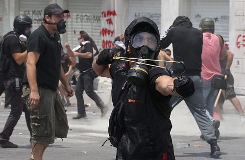 http://roarmag.org/wp-content/uploads/2011/06/J-29-austerity-riots-Greece-crop-38.jpg