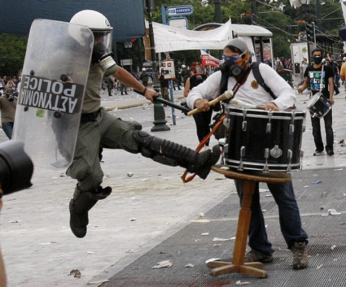 http://roarmag.org/wp-content/uploads/2011/06/J-29-austerity-riots-Greece-crop-39.jpg