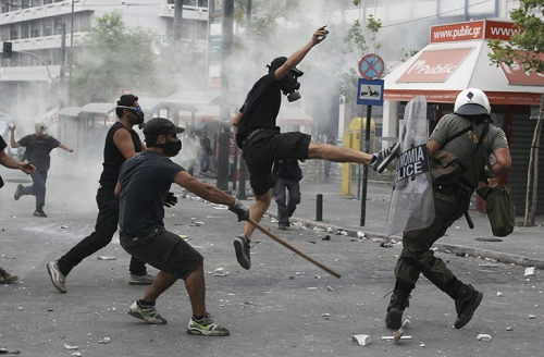 http://roarmag.org/wp-content/uploads/2011/06/J-29-austerity-riots-Greece-crop-40.jpg