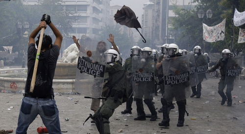 http://roarmag.org/wp-content/uploads/2011/06/J-29-austerity-riots-Greece-crop-41.jpg