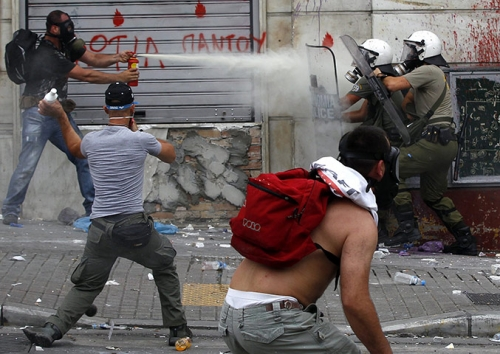 http://roarmag.org/wp-content/uploads/2011/06/J-29-austerity-riots-Greece-crop-43.jpg