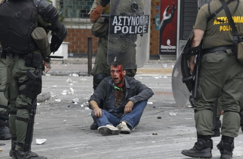 http://roarmag.org/wp-content/uploads/2011/06/J-29-austerity-riots-Greece-crop-45.jpg