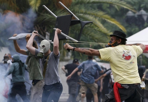 http://roarmag.org/wp-content/uploads/2011/06/J-29-austerity-riots-Greece-crop-46.jpg
