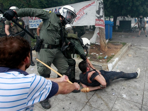 http://roarmag.org/wp-content/uploads/2011/06/J-29-austerity-riots-Greece-crop-47.jpg