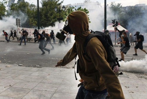 http://roarmag.org/wp-content/uploads/2011/06/J-29-austerity-riots-Greece-crop-50.jpg