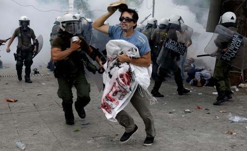 http://roarmag.org/wp-content/uploads/2011/06/J-29-austerity-riots-Greece-crop-51.jpg