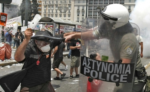 http://roarmag.org/wp-content/uploads/2011/06/J-29-austerity-riots-Greece-crop-52.jpg