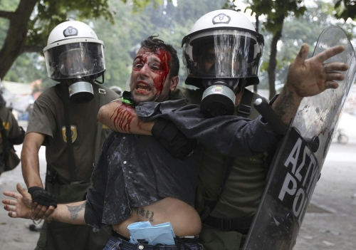 http://roarmag.org/wp-content/uploads/2011/06/J-29-austerity-riots-Greece-crop-53.jpg