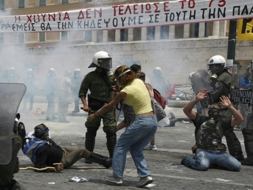 http://roarmag.org/wp-content/uploads/2011/06/J-29-austerity-riots-Greece-crop-54.jpg