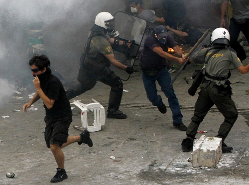 http://roarmag.org/wp-content/uploads/2011/06/J-29-austerity-riots-Greece-crop-55.jpg