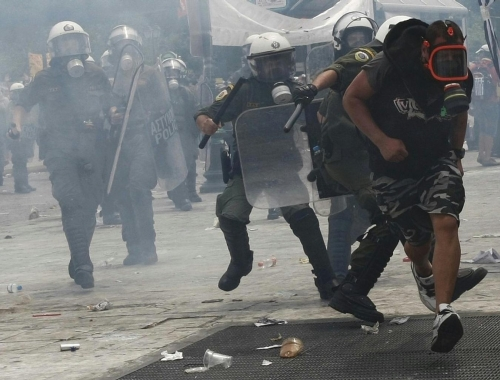 http://roarmag.org/wp-content/uploads/2011/06/J-29-austerity-riots-Greece-crop-57.jpg