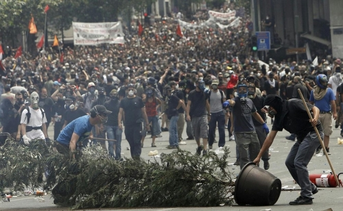http://roarmag.org/wp-content/uploads/2011/06/J-29-austerity-riots-Greece-crop-64.jpg