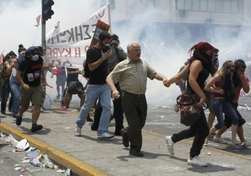 http://roarmag.org/wp-content/uploads/2011/06/J-29-austerity-riots-Greece-crop-65.jpg
